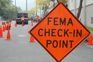 http://upload.wikimedia.org/wikipedia/commons/b/be/FEMA_-_35206_-_FEMA_Check_in_sign_in_Hawaii.jpg